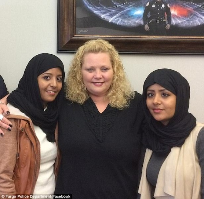 Secretary filmed hurling racist abuse at Somali women reconciles with them and poses for a photograph as they forgive her