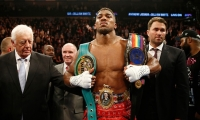 Anthony Joshua beats Dillian Whyte to become British heavyweight champion