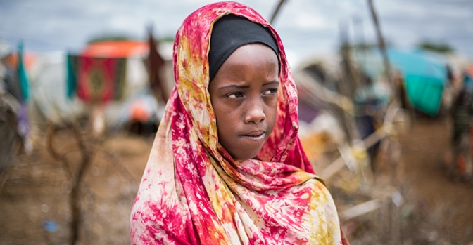 Halima*, 13, outside her makeshift hut in an IDP camp in Somalia. Halima's right leg was injured in a bomb blast when she was working in a tea shop. Photo credit: Mustafa Saeed/Save the Children.